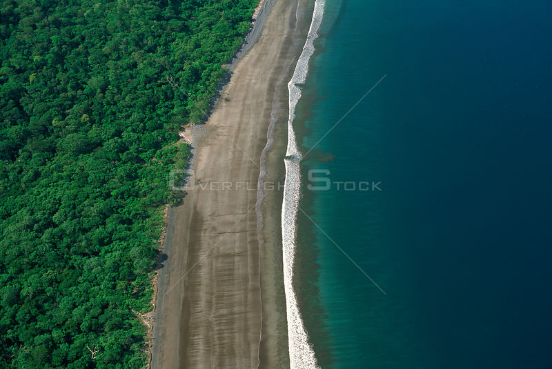 Aerial of Pacific coast tropical dry forest and sea, Santa Rosa NP, Costa Rica, Central America