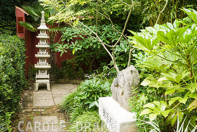 Chinese granite pagoda in the Red Wall garden planted around with palm Trachycarpus wagnerianus and Edgeworthia chrysantha. '...