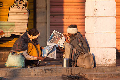 Sadhus read newspapers on the street in Jodhpur, Rajasthan, India