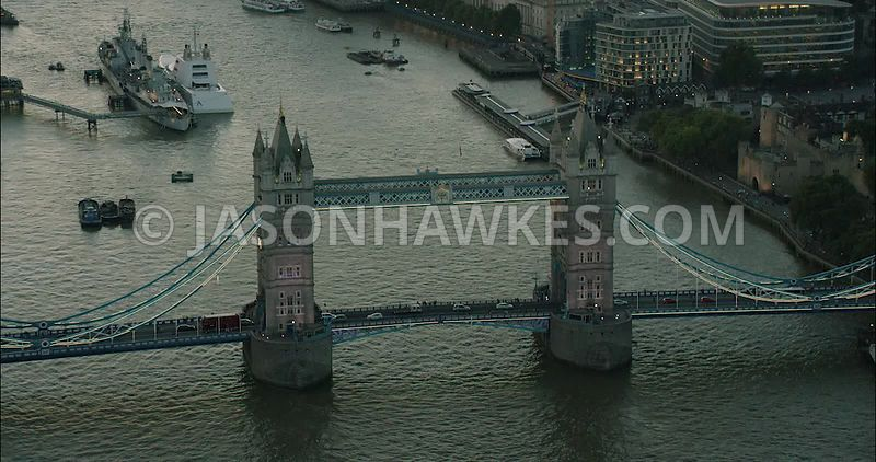 London Aerial Footage of River Thames with Tower Bridge and HMS Belfast.