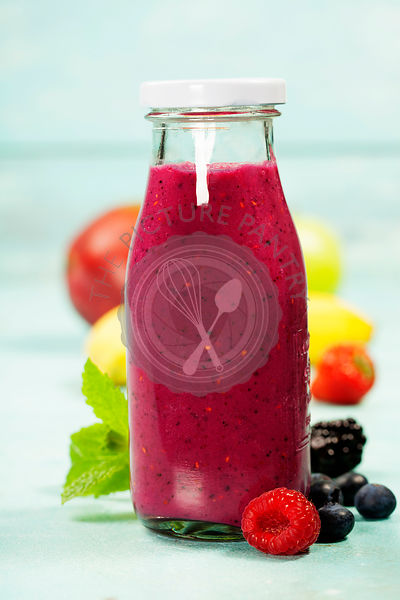 Berry smoothie on blue rustic background - Healthy eating, Detox or Diet concept