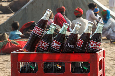 Cases of Coca-Cola glass bottles at the Pushkar Camel Mela, Pushkar, India.
