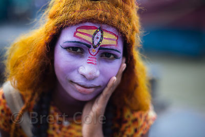 A boy dressed as Shiva to make money from India photographers taking his photos during Mahalaya observance, Babughat, Kolkata...