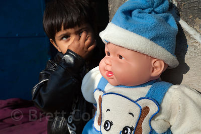 A boy and his doll in Jodhpur, Rajasthan, India