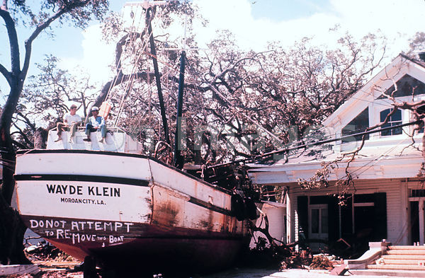 Grounded fishing boat in Biloxi after Hurricane Camille, 1969