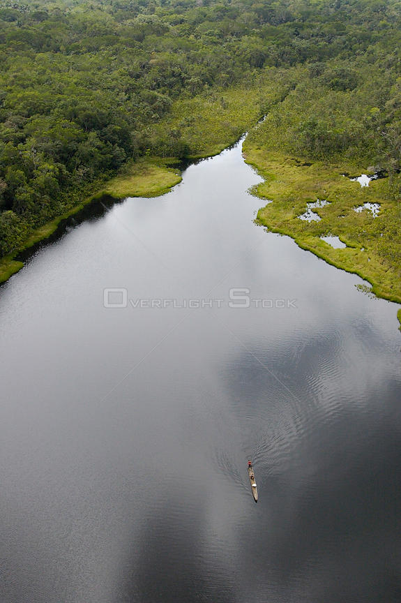 Aerial view of Ox-bow lake with dugout canoe,.Yasuni National Park Biosphere Reserve.Amazon Rain Forest. Ecuador South Americ...