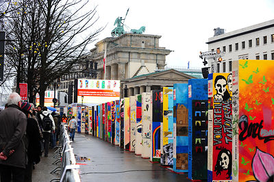Massive colorful dominoes painted by German students, marking the 20th anniversary of the fall of the Berlin Wall on November...