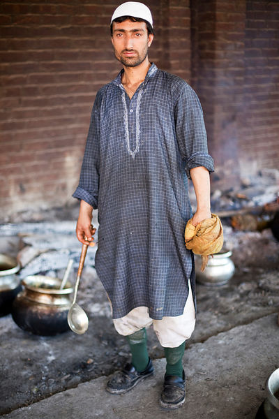 India - Srinagar - A portrait of Zahour, 26 a Waza - a traditional Kashmiri chef, at a Wazwan, a Kashmiri feast