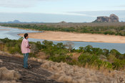 Tourist overlooking the Lugenda river, Niassa Game Reserve, Mozambique