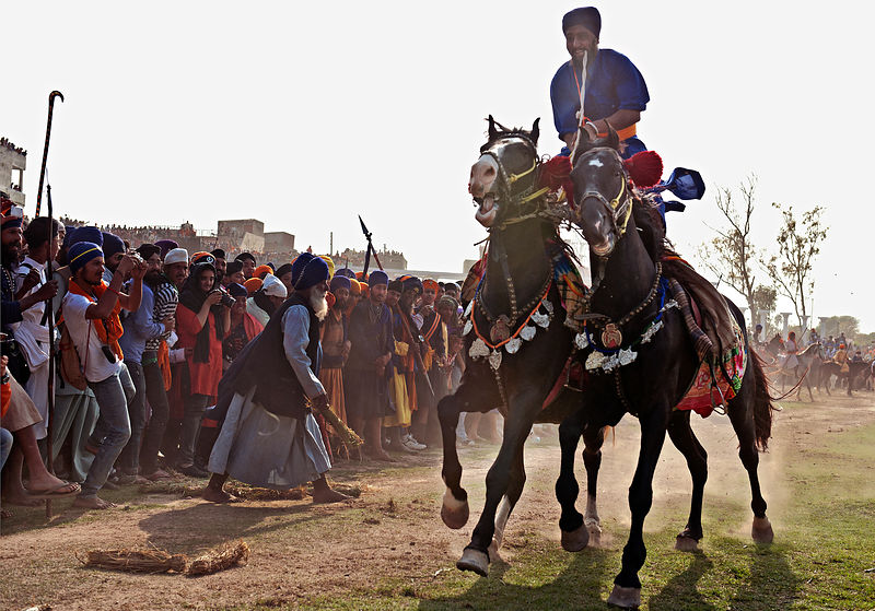 This photograph of a nihang warrior showing of his balancing skills on the ground during the holla mohalla festival was shot ...
