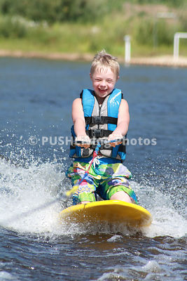 Young boy adaptive water skiing