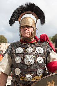 People in costume celebrating the anniversary of the founding of Rome.