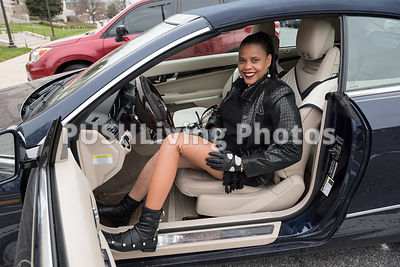 Woman with a prosthetic leg getting into her car