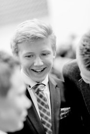 Young Nordic boy in suit and bluish tie (black/white picture)