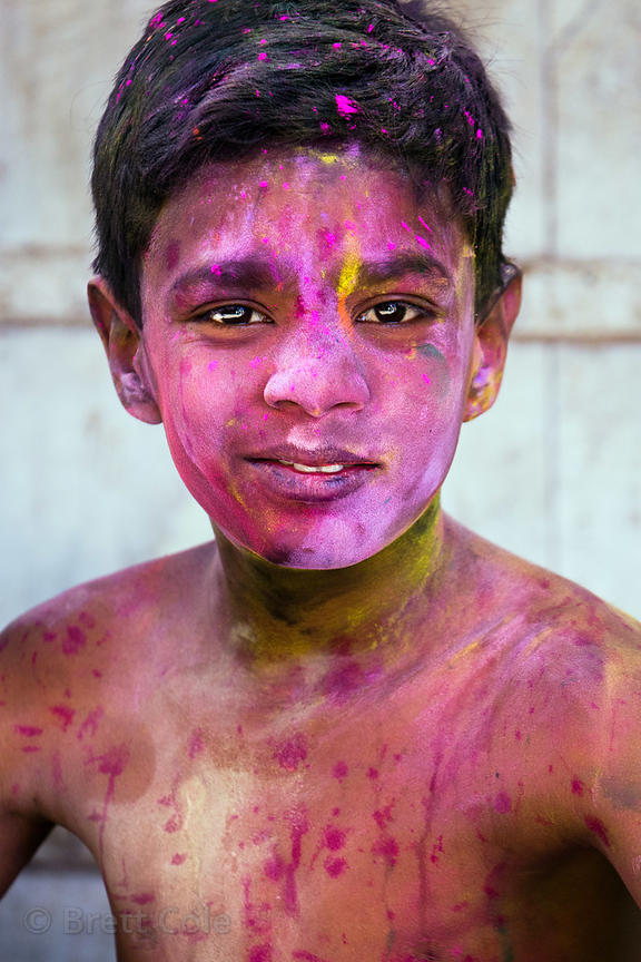 Boy covered in gulal powder during the Holi festival, Pushkar, Rajasthan, India