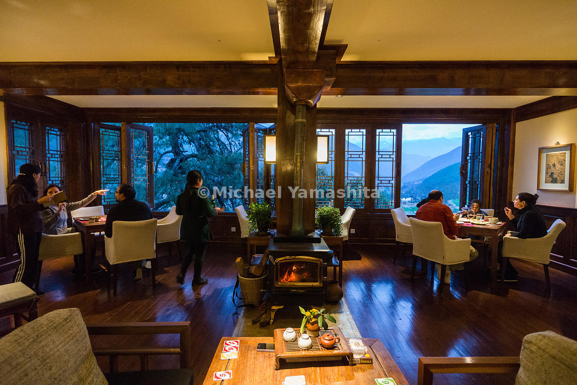 Guests at the Songtsam Tacheng lodge dine on indigenous dishes—including yak meat—by windows open to deep mountain valleys. T...