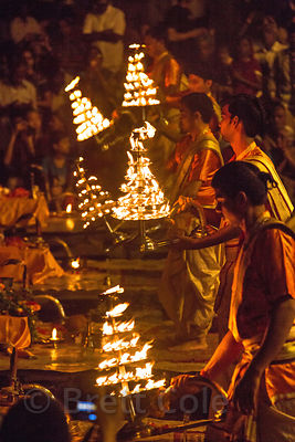 Pujari wave candleabras during Ganga Aarti, Dashashwamedh Ghat, Varanasi, India