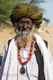 Characterful elderly man wearing an impressive amber necklace, Chainpura village, Rajasthan, India
