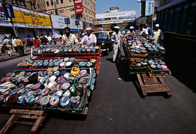 India - Mumbai - Dhabawallahs push their carts through the traffic