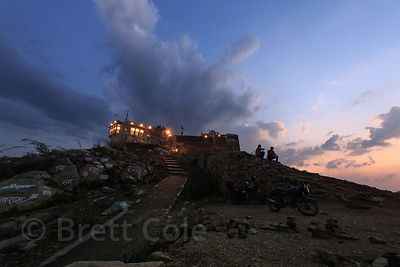 Lights come on at dusk at a large Hindu temple above Kishangarh, Rajasthan, India