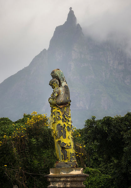 Statue with Pieter Both Mountain behind, Pamplemousse cemetery, Mauritius.