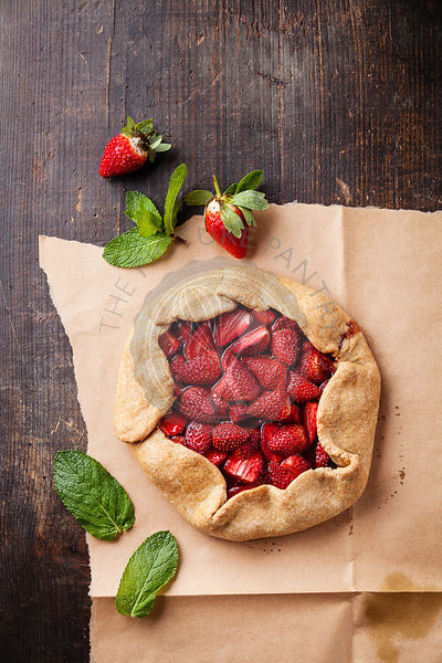 Strawberry pie on wooden background