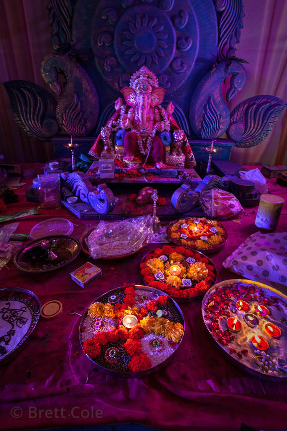Beautiful Ganesh pandal decorated with candles and flowers during the Ganesh Chaturthi festival in Shekwalhi, Mumbai, India.