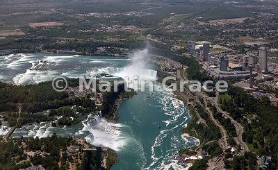 Niagara Falls from the air, looking over Niagara River to American Falls, Bridal Veil Falls and Goat Island (left - USA); Can...