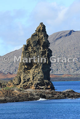 Pinnacle Rock, Bartolome Island, with Santiago behind, Galapagos Islands