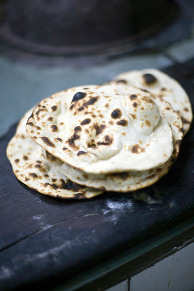 India - Delhi - A plate of chapati at the Village Restaurant in Siri Fort
