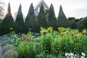Crown imperials, Fritillaria imperialis, in yellows and oranges dominate planting in the Canal Garden in April, surrounded by...