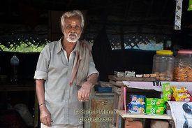 Shopkeeper at store front, Vedanthangal Bird Sanctuary, Tamil Nadu, India
