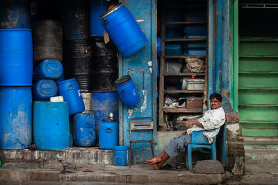 A man tends a shop in the Dharavi slum, Mumbai, India.