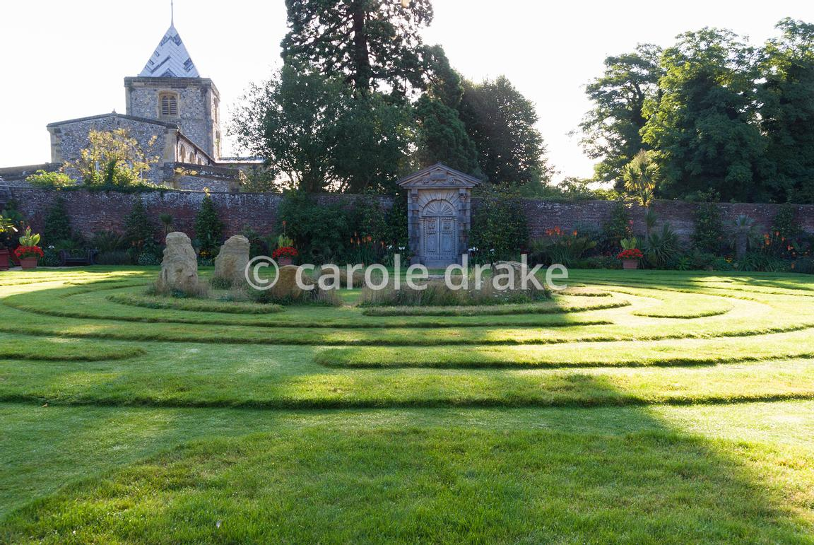 A grass maze with central stones occupies the centre of the Collector Earl's Garden, designed by Julian and Isabel Bannerman,...