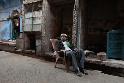 Muslim butcher relaxes outside of his shop in Jodhpur, Rajasthan, India