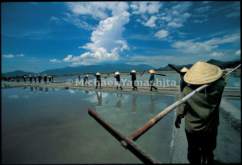 Cam Ranh Bay, Vietnam. People are granted the privilage of boiling seawater to make salt.