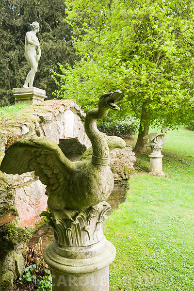 Upper Cascade is surmounted by a statue of Venus framed by a pair of swans, in Venus' Vale. Rousham House, Bicester, Oxon, UK