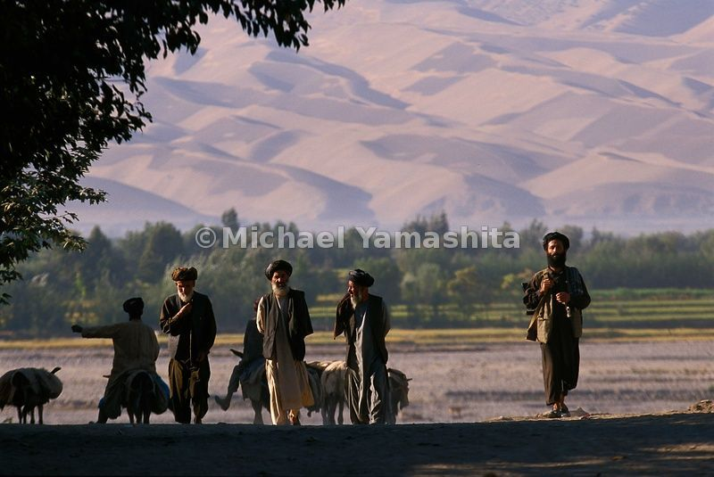 A group of proud inhabitants in the province of Takhar advance on to Taloqan.