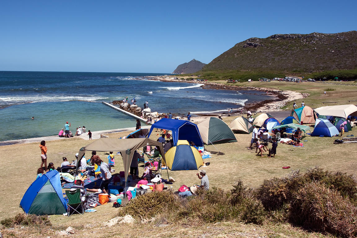 A packed crowd on Christmas day at Buffels Bay, heart of the territory of the Buffels Bay chacma baboon troop. The park servi...