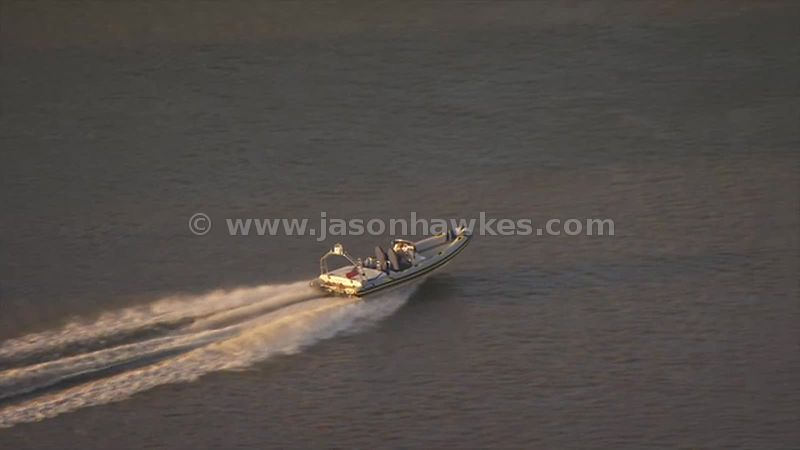Aerial footage of boat on the River Thames, London