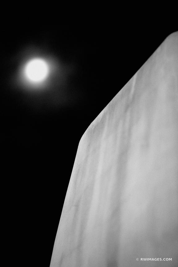 FULL MOON AND ADOBE ARCHITECTURE BUILDING SANTA FE NEW MEXICO BLACK AND WHITE