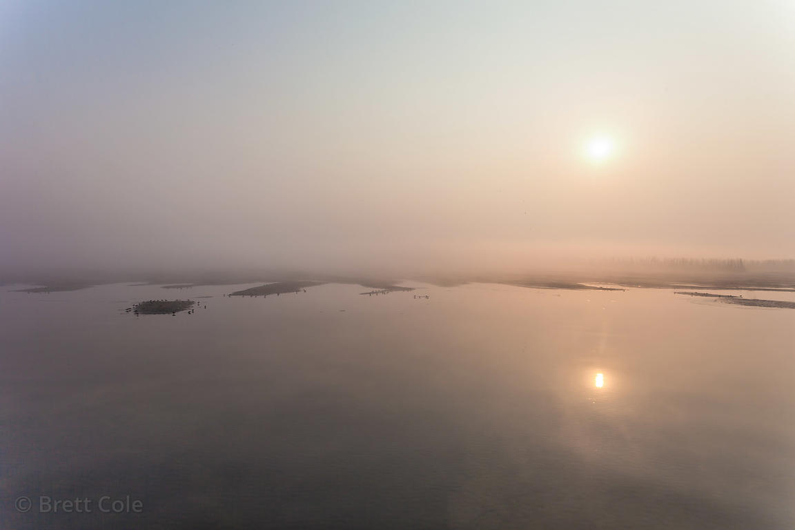Misty winter sunrise on the Ganges River, Varanasi, India.