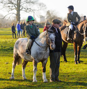 A child on a pony at the meet at Pickwell Manor - The Cottesmore Hunt at Pickwell Manor 28/12