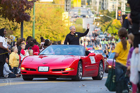 On air talent and UI Alum Ron Steele rides along in the 2012 University of Iowa homecoming Parade on Washington St in Iowa Ci...