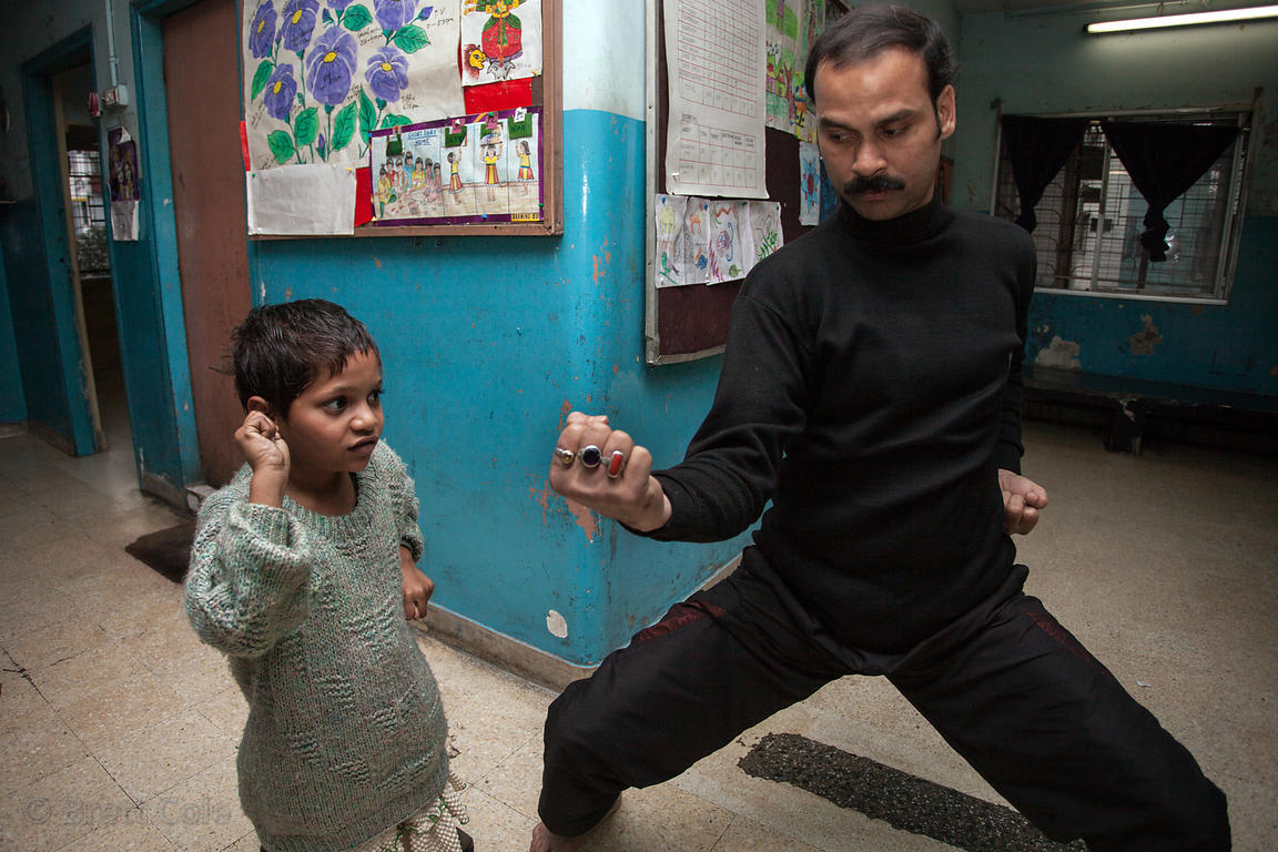 Girls receive karate lessons at the CINI (cinindia.org) girls shelter at Amader Bari, Kolkata, India