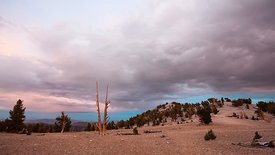 Wide Shot: Dramatic Cloud Covered Sunset From The Peaks of the White Mountains (Day To Night)