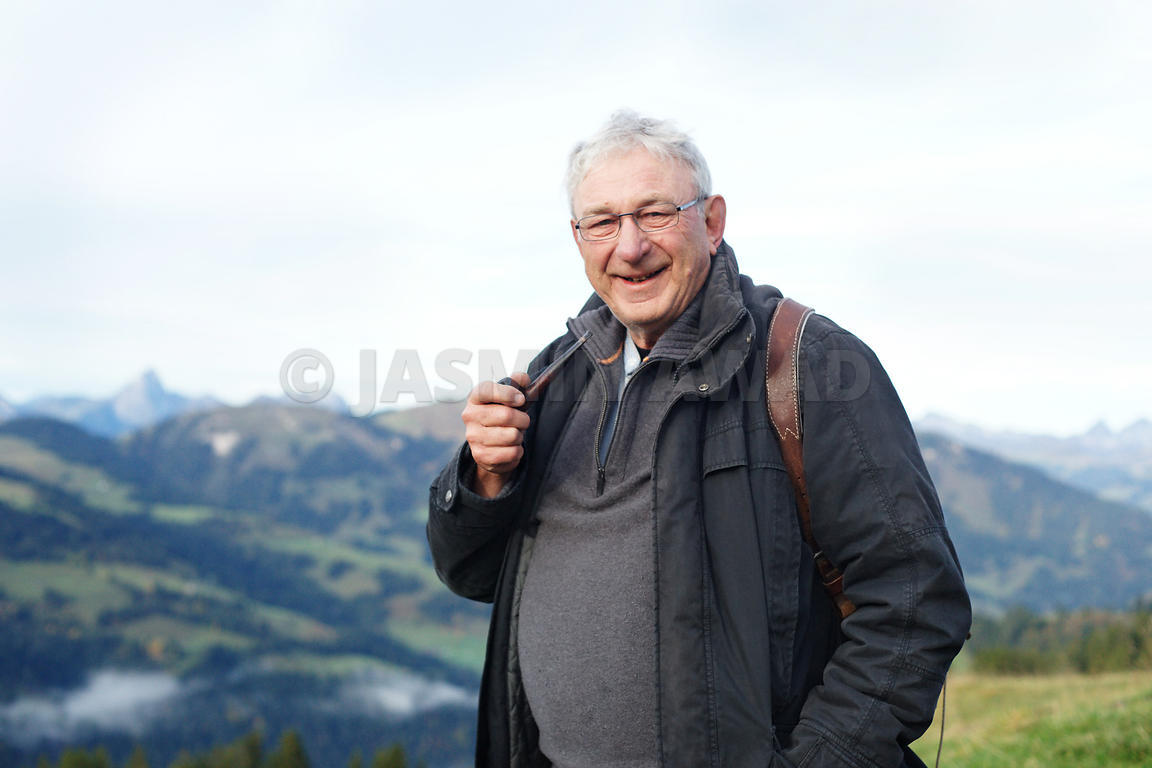 Senior man hiking in the mountains series