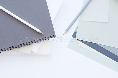 business desktop from above with design objects, scrapbooks - copyspace for your text - top view