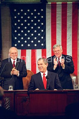 Vice President Dick Cheney and House Speaker Dennis Hastert applaud President George W. Bush Feb. 27, 2001, during a speech t...