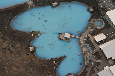 Aerial of tourists bathing in geothermal pool, Iceland, July 2009.